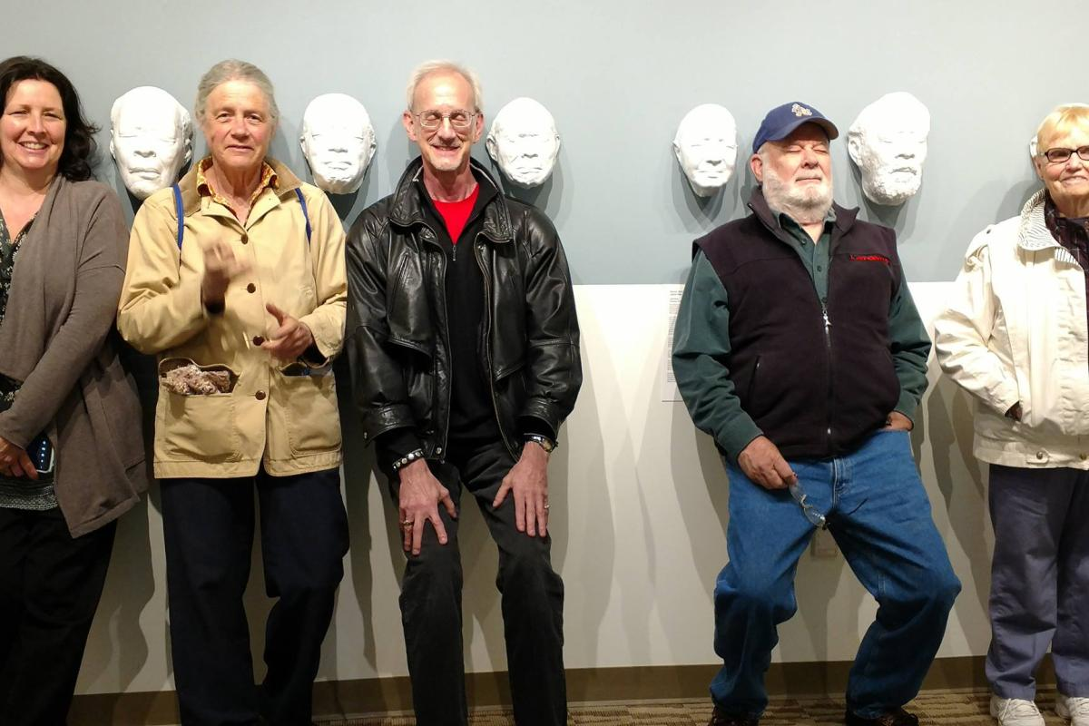 Posing with Masks at An Art Gallery During a Back to Campus Event at Endicott College