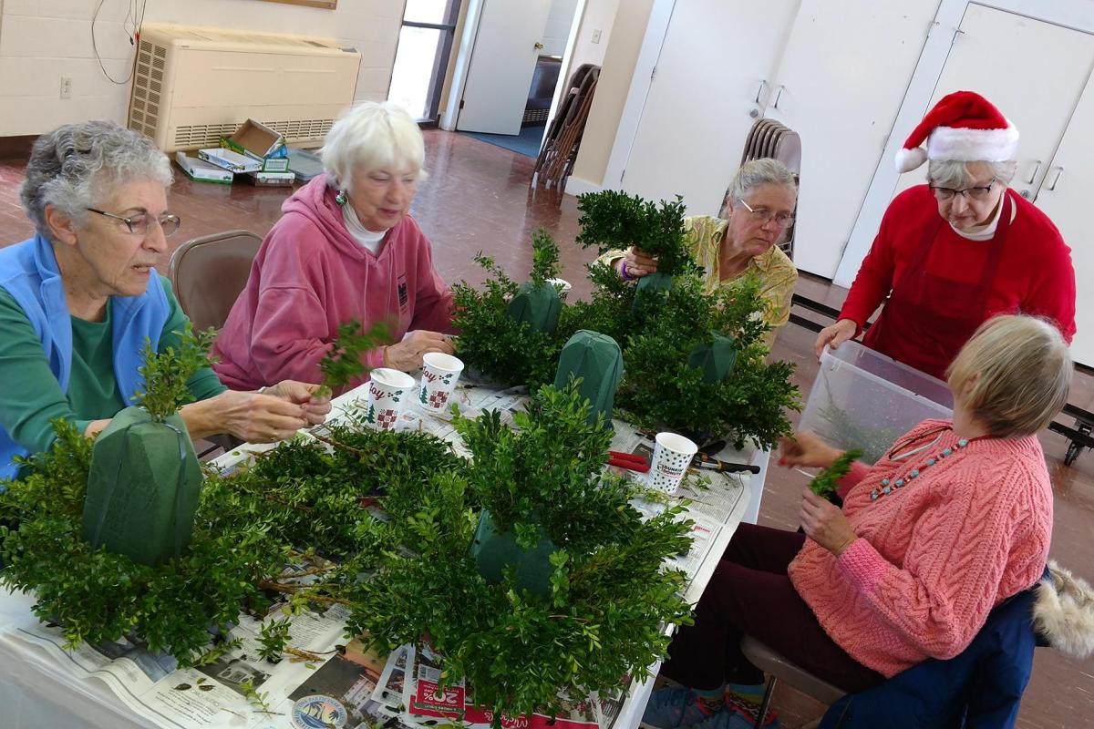 A Favorite Holiday Tradition is the Boxwood Tree Construction Workshop Sponsored by the New Meadows Garden Club