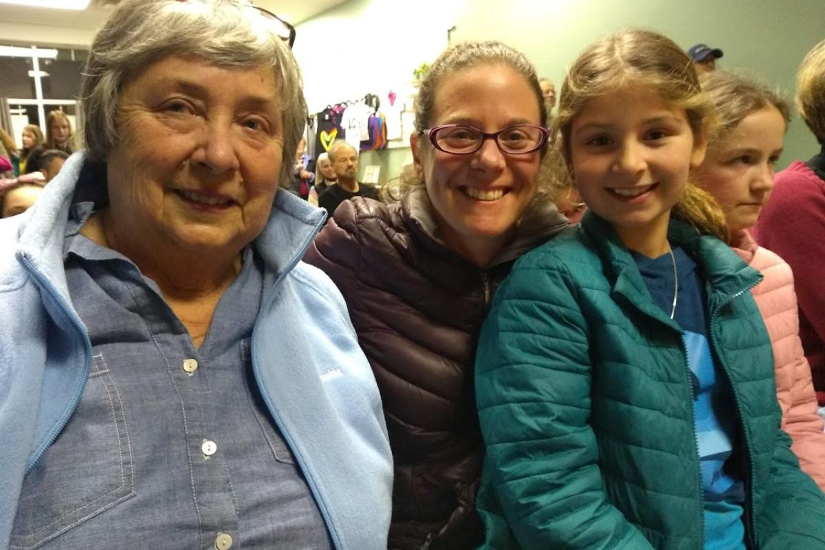 Three Generations of a Family Sit Together at an Event