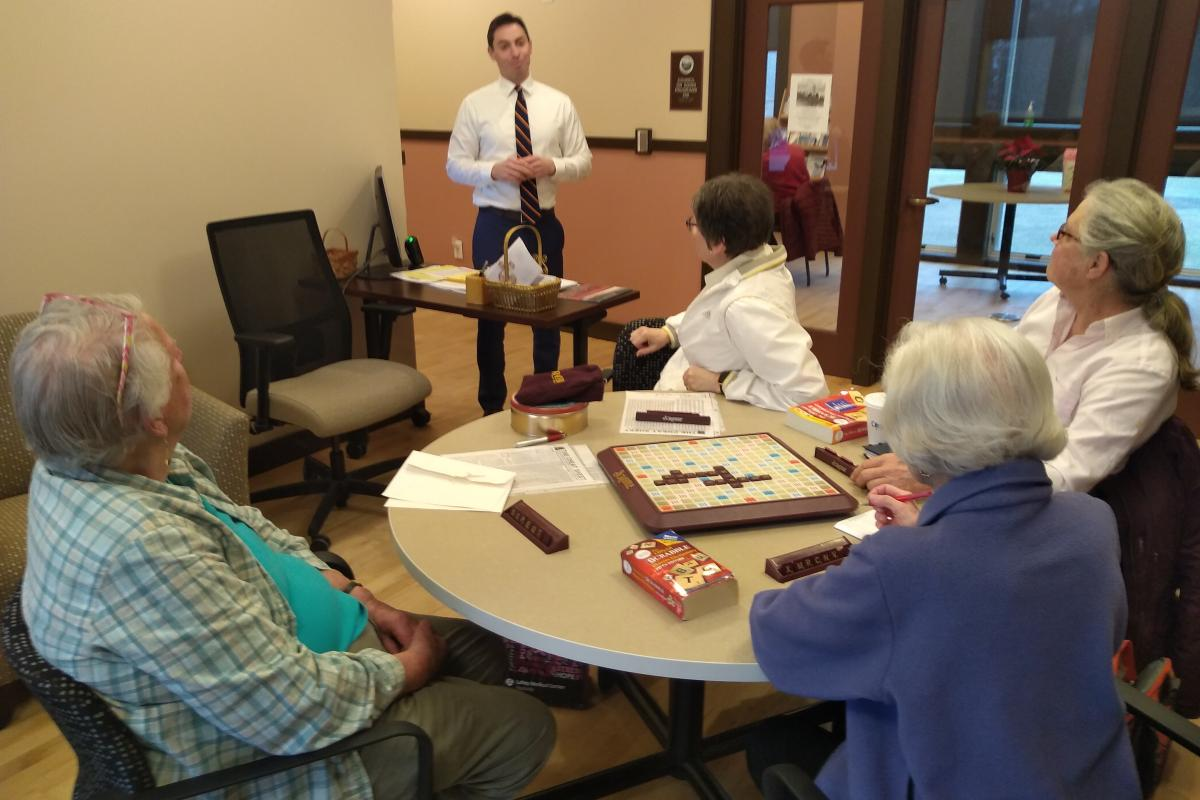 New Town Administrator Addresses a Group Playing Scrabble
