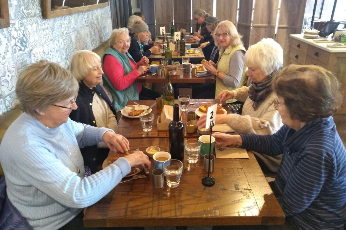 A Group of Diners Enjoy Breakfast at New Restaurant