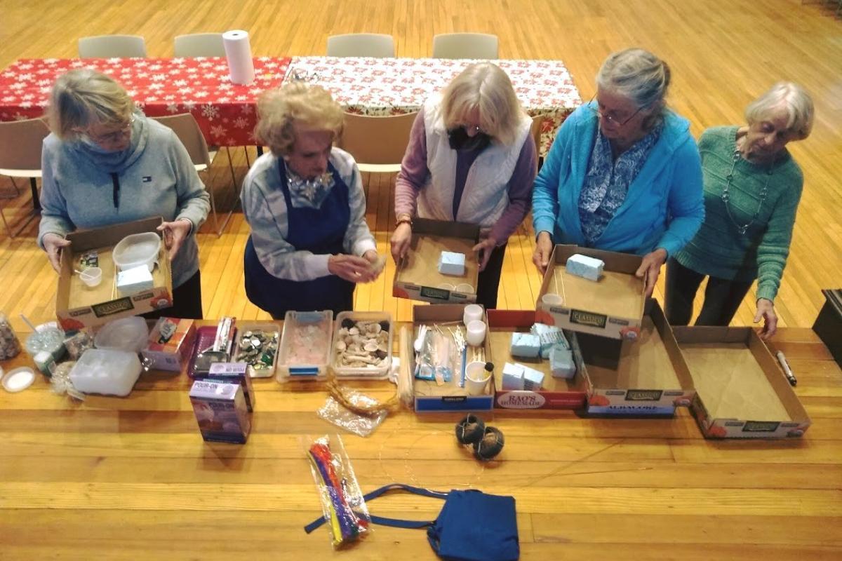 Five Women Get Supplies for Art Project
