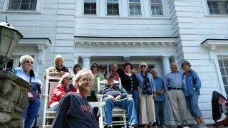 A group of adventurers from the Topsfield COA hang out on a seaside porch!